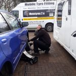 Mototyres 2 u Mobile Tyre fitting Lincolnshire Holbeach Tyres Lee Fitting Tyres On Drive between car and caravan